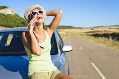 Woman talking on  cellphone during summer car travel. Happy woman on cellphone call enjoying summer car travel vacation. Female traveler  on roadtrip in Spain Stock Photos