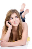 Woman talking by cellural phone. Woman talking by mobile phone Stock Photo