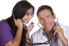 Woman talking in doctors stethoscope Royalty Free Stock Photography