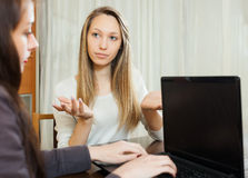 Woman talking with employee Stock Photos