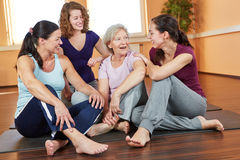 Woman talking in fitness center. Happy group of smiling women talking in a fitness center Stock Image