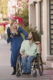 Woman Chatting with Man in Wheelchair Royalty Free Stock Photography