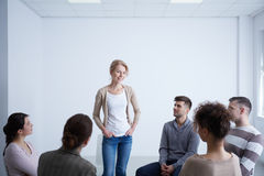 Woman talking during group therapy Stock Photography