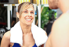 Woman talking in a gym Royalty Free Stock Images