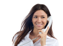 Woman talking on the handset phone Stock Images