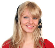 Woman Talking on a headet. Woman working on a hotline at a customer service department Royalty Free Stock Photography