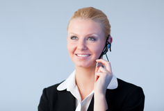 Woman talking on a headset Royalty Free Stock Images