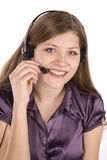 Woman talking on headset Stock Photography