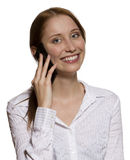 Woman talking on her cell phone. Attractive young business woman talking on her mobile phone in white shirt blouse, isolated Stock Photo