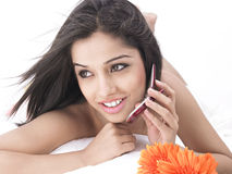 Woman talking on her cell phone Stock Image