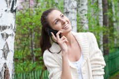 Woman talking on her mobile phone Stock Photos