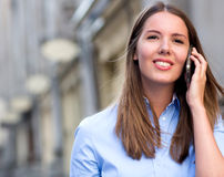 Woman talking on her mobile phone Stock Photo