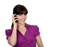 Woman talking on her phone Stock Images