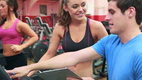 Woman talking with her trainer stock footage