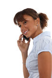 Woman talking on herphone Royalty Free Stock Image
