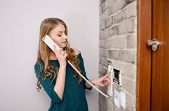 Woman talking on the intercom Stock Images