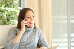 Woman talking on a land line phone Royalty Free Stock Images