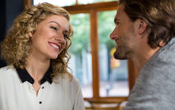Woman talking with man in coffee shop Stock Images