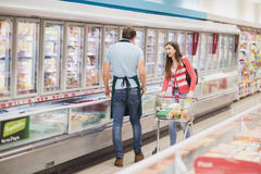 Woman talking with a man grocer Stock Images