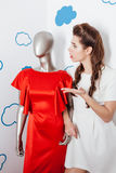 Woman talking with manikin Stock Photography
