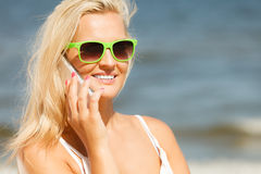Woman talking on mobile cell phone by seaside Stock Photo