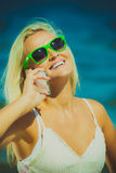 Woman talking on mobile cell phone by seaside Stock Photos