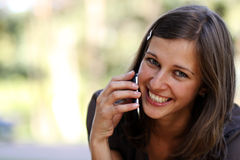 Woman talking on mobile phone Royalty Free Stock Photos
