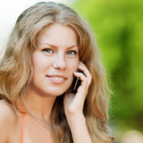 Woman talking mobile phone Stock Images