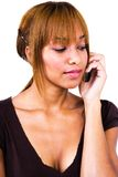 Woman talking on mobile phone Stock Photography