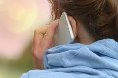 Woman talking on the mobile phone royalty free stock photos