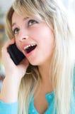 Woman talking on mobile phone. Closeup portrait of a young smiling pretty woman talking on mobile phone Royalty Free Stock Photos