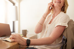 Woman talking on mobile phone Stock Photo