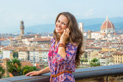 Woman talking mobile phone in florence, italy Royalty Free Stock Images