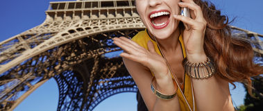 Woman talking on mobile phone in front of Eiffel tower, Paris Stock Image