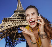 Woman talking on mobile phone in front of Eiffel tower, Paris Stock Photography
