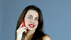 Woman Talking on Mobile Phone on grey background stock video footage