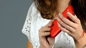 Woman Talking on Mobile Phone on grey background stock video