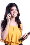 Woman talking mobile phone Royalty Free Stock Photography