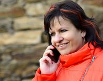 Woman talking on mobile phone Stock Images