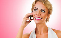 Woman talking on mobile phone Stock Photos