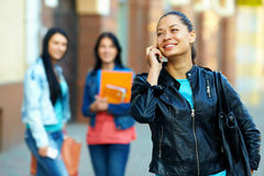 Woman talking on mobile phone, on the street stock images