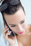 Woman talking on the mobile phone Stock Photos