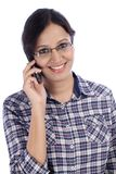 Woman talking on a mobile phone Royalty Free Stock Photography
