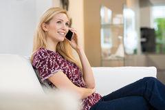 Woman talking over phone Royalty Free Stock Photo