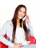 Woman talking over phone at home. Young woman talking over phone at home Royalty Free Stock Photo