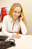 Woman talking by phone. Royalty Free Stock Photos