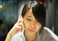 Woman talking on the phone Stock Photos
