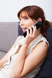 Woman talking on phone Royalty Free Stock Photos
