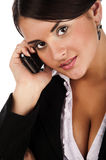 Woman talking on the phone. Sexy woman talking on the phone, closeup portrait, isolated on white image Stock Image