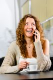 Woman is talking phone Royalty Free Stock Photo